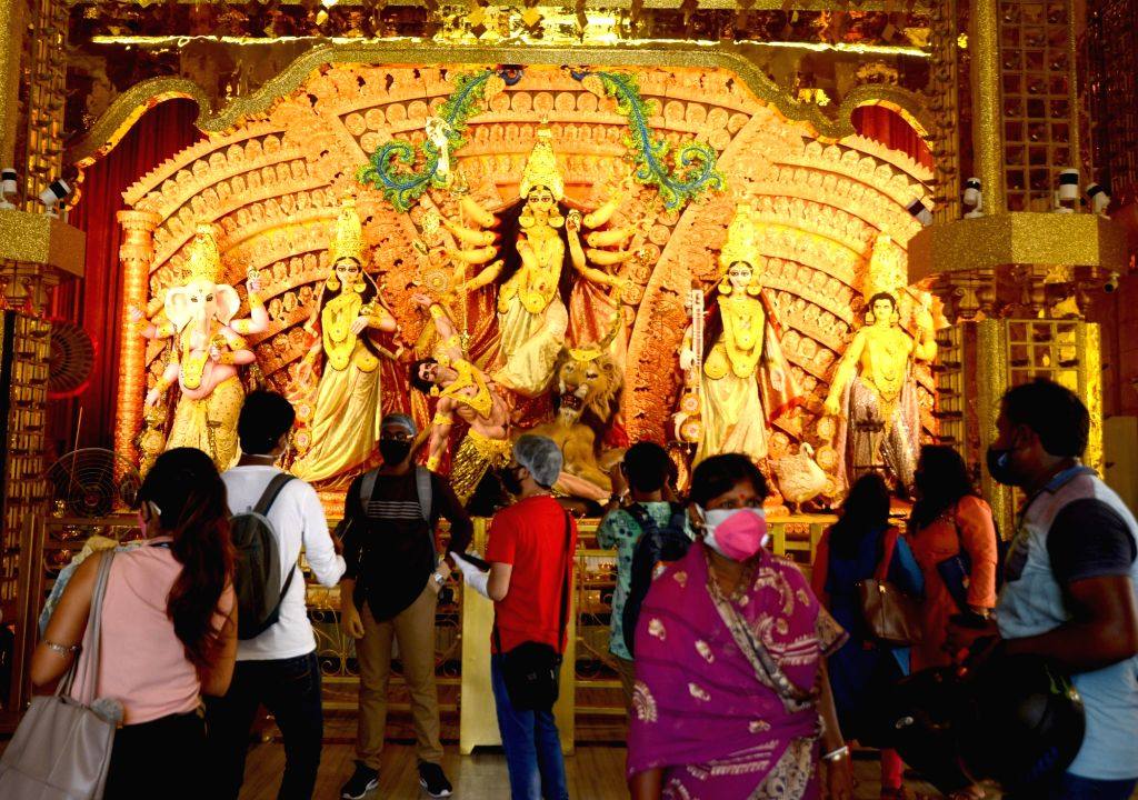 Visitors at the community puja pandal on the theme of the Kedarnath Temple ahead of Durga Puja celebrations, at Sree Bhumi Sporting Club in Kolkata on Oct 20, 2020.