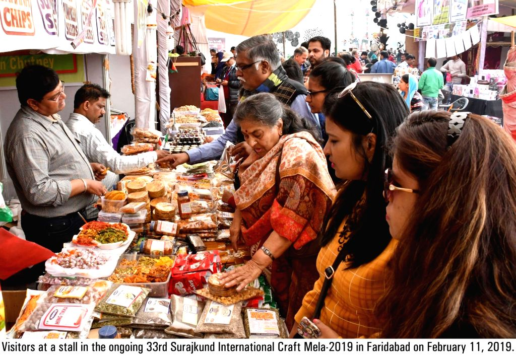 Visitors at the ongoing 33rd Surajkund International Craft Mela-2019 in Faridabad on Feb 11, 2019.
