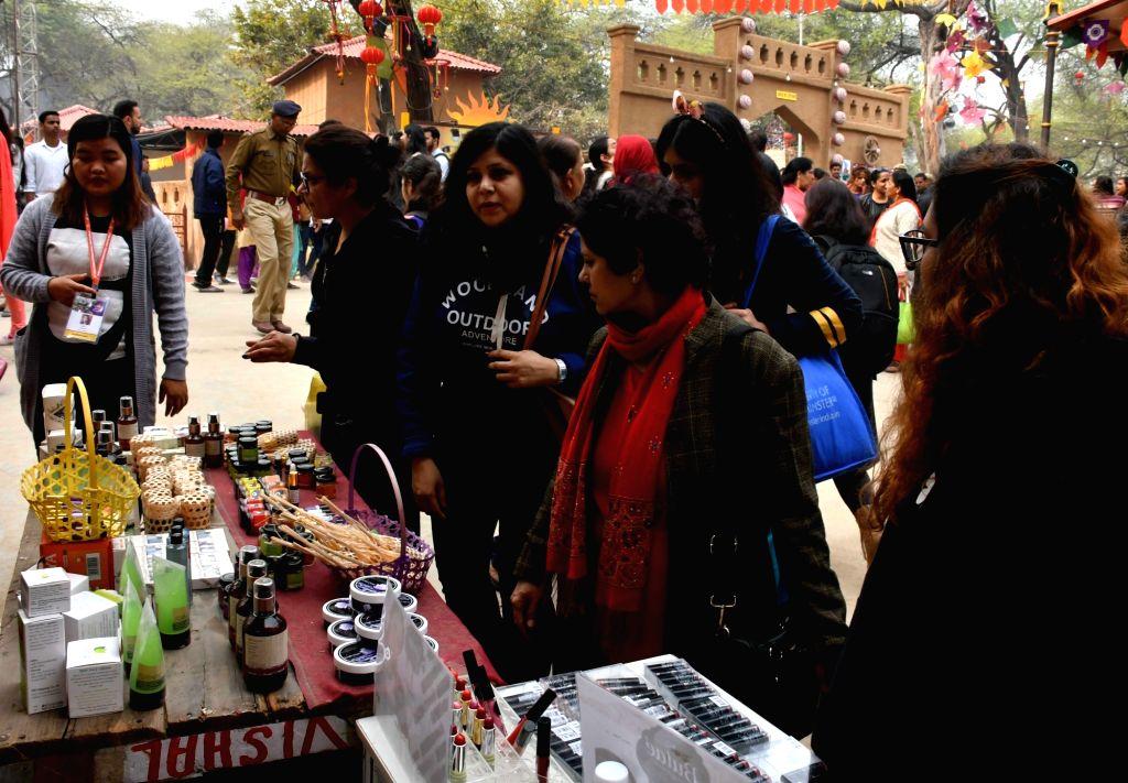 Visitors at the ongoing 33rd Surajkund International Craft Mela-2019 in Faridabad on Feb 12, 2019.
