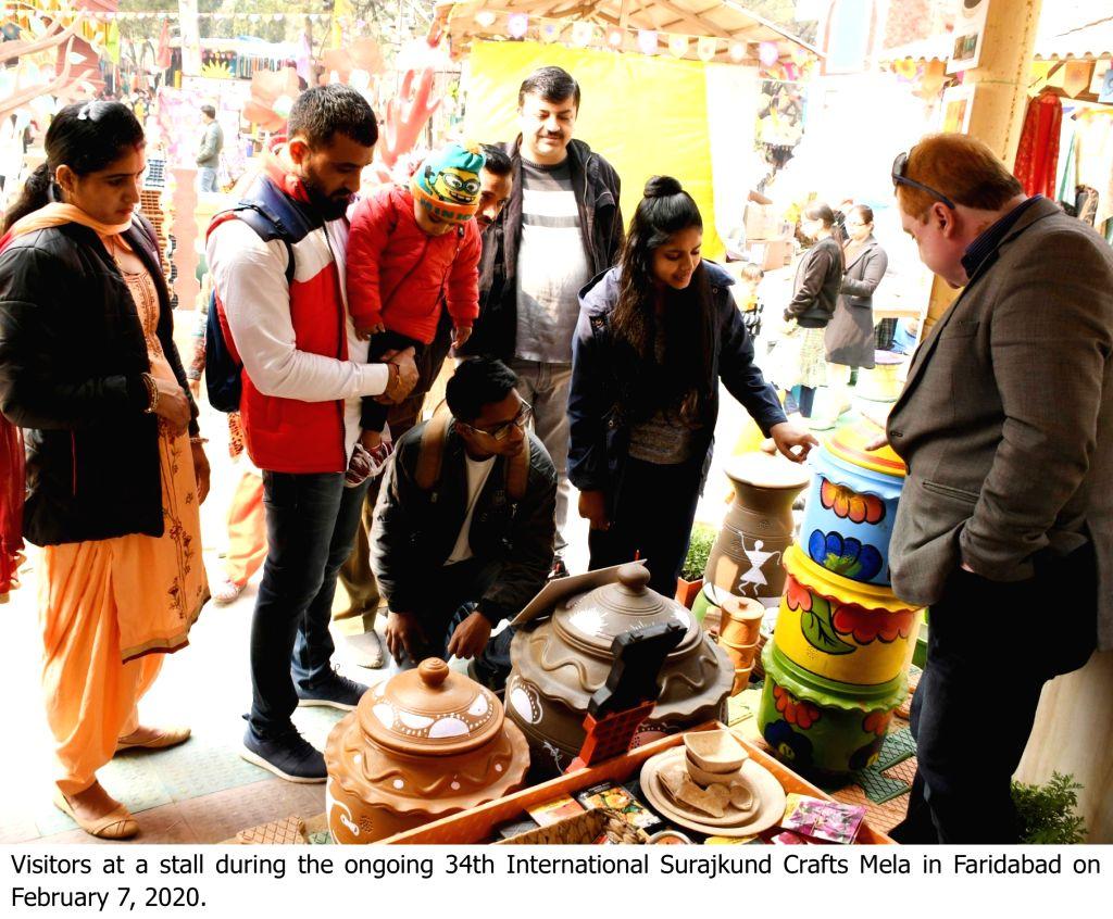 Visitors at the ongoing 34th International Surajkund Crafts Mela in Faridabad, Haryana on Feb 7, 2020.