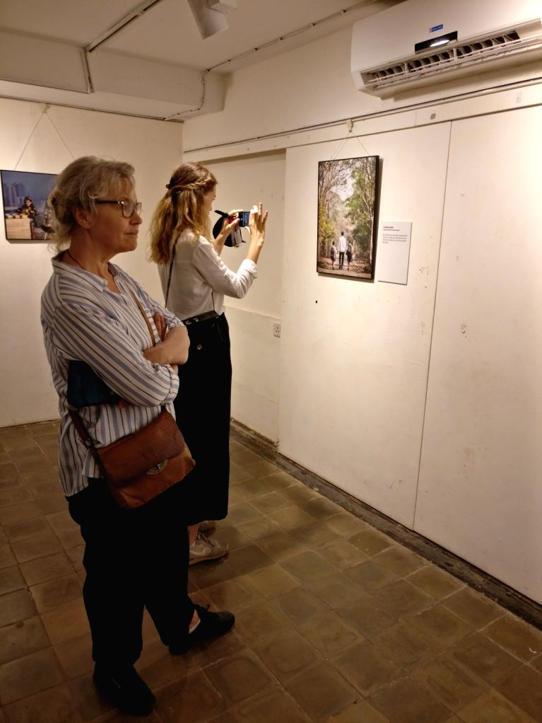 """Visitors at the """"Swedish Dads - Indian Dads"""" a photo exhibition on gender sensitive parenthood to India, in Mumbai on Feb. 2, 2019."""