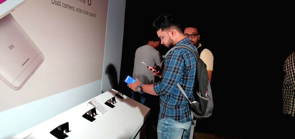 Visitors check out the features of newly launched Xiaomi Redmi 6 series smartphone, in New Delhi, on Sept 5, 2018. Also launched Xiaomi Redmi 6A and Redmi 6 Pro smartphone.