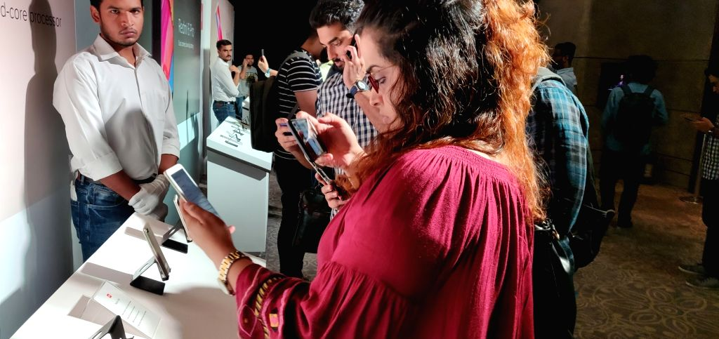 Visitors check out the features of newly launched Xiaomi Redmi 6A series smartphone, in New Delhi, on Sept 5, 2018. Also launched Xiaomi Redmi 6 and Redmi 6 Pro smartphone.