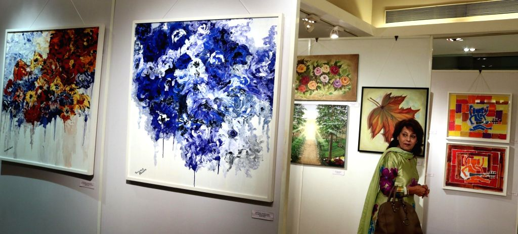 Visitors during an art exhibition in New Delhi on March 9, 2017.