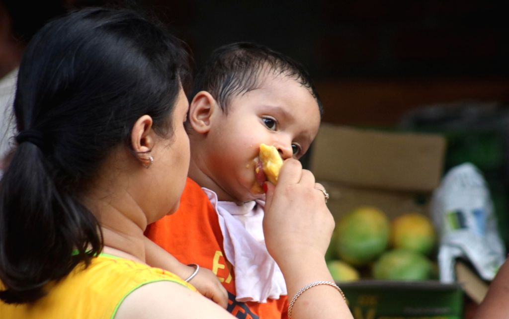 Visitors during the Mango Festival at Dilli Haat in New Delhi on June 24, 2016.
