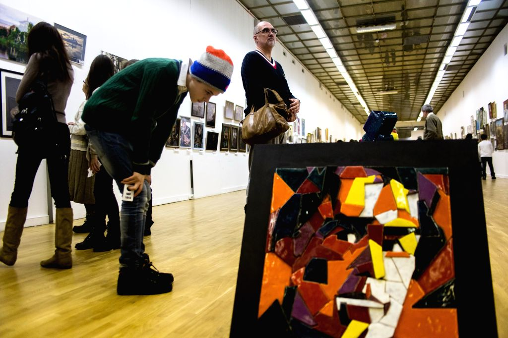 "Visitors enjoy artworks during ""Russian ArtWeek"" opening exposition in Moscow, Russia, on Jan. 16, 2016. XIX International contest-exposition ""Russian ..."