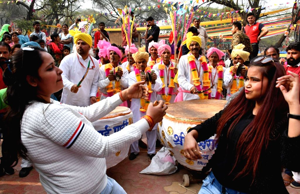Visitors enjoy dancing at the 33rd Surajkund International Crafts Mela, in Faridabad, on Feb 14, 2019.