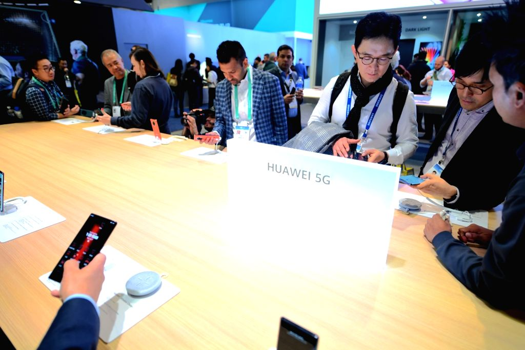 Visitors experience 5G products at the booth of Huawei at the 2020 Consumer Electronics Show in Las Vegas, the United States, Jan. 7, 2020. The annual tech show, ...