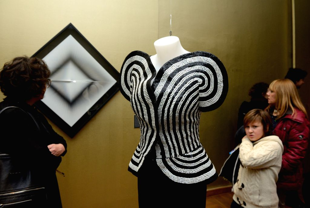 Visitors look at artworks during the opening ceremony of the Moving Eye Exhibition at the Museum of Arts and Crafts in Zagreb, Croatia, Jan. 14, 2016. The exhibition ...
