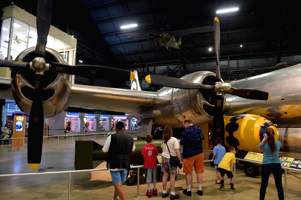 """Visitors look at demilitarized atom bombs, nicknamed """"Little Boy"""" (L) and """"Fat Man"""" (R), and the Bockscar B-29 bomber at the National Museum of ..."""
