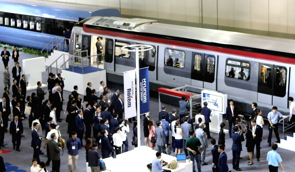Visitors look at Hyundai Rotem-made trains for the Hong Kong subway at the 2017 RailLog Korea, one of the world's four largest rail industry expos, which opened for a four-day run at an exhibition ...