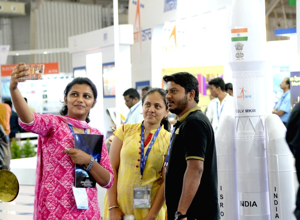 Visitors pose for a selfie at the 6th Bengaluru Space Expo (BSX) 2018, in Bengaluru on Sept 6, 2018.