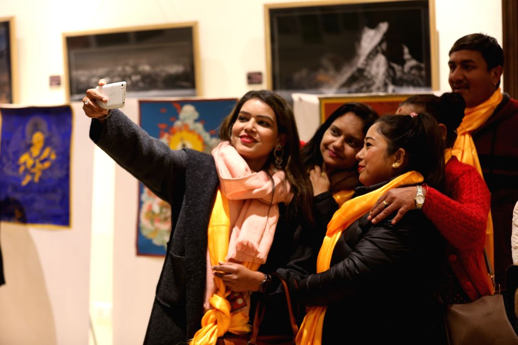 Visitors take a selfie at an exhibition promoting China's Qinghai Province, in Kathmandu, Nepal, Jan. 9, 2020. Qinghai Province in northwest China promoted itself ...