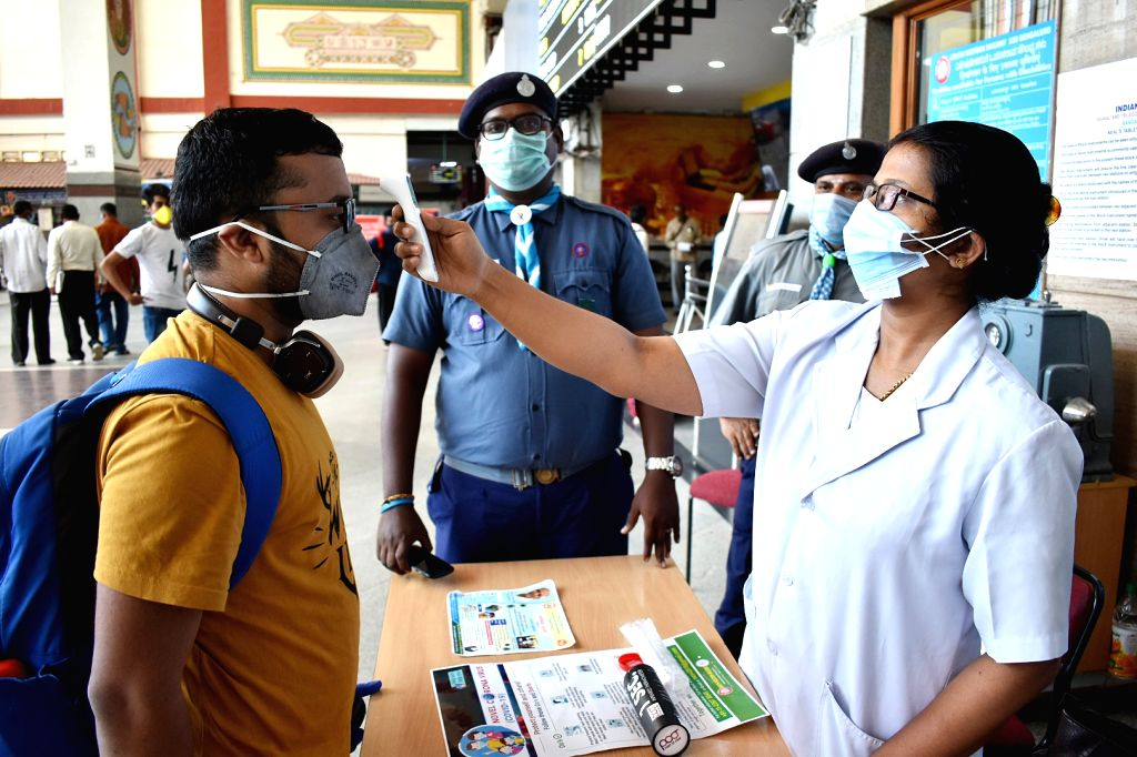 Visitors undergoing Thermal Scanning at City Railway Station amid Coronavirus outbreak, in Bengaluru on Thursday 19 March 2020.
