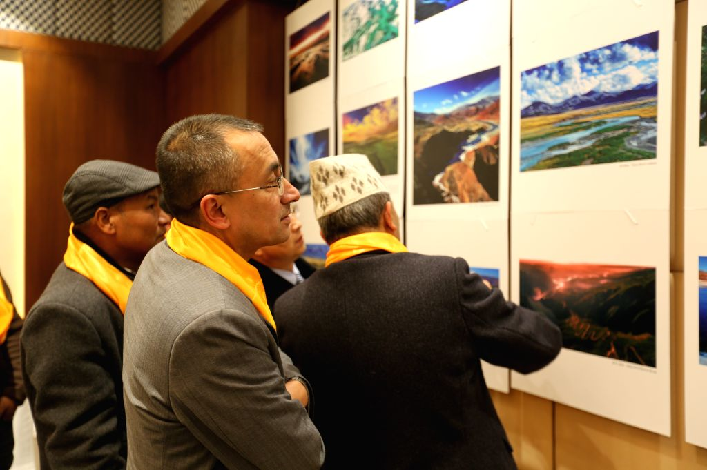 Visitors view photos during an exhibition promoting China's Qinghai Province, in Kathmandu, Nepal, Jan. 9, 2020. Qinghai Province in northwest China promoted ...