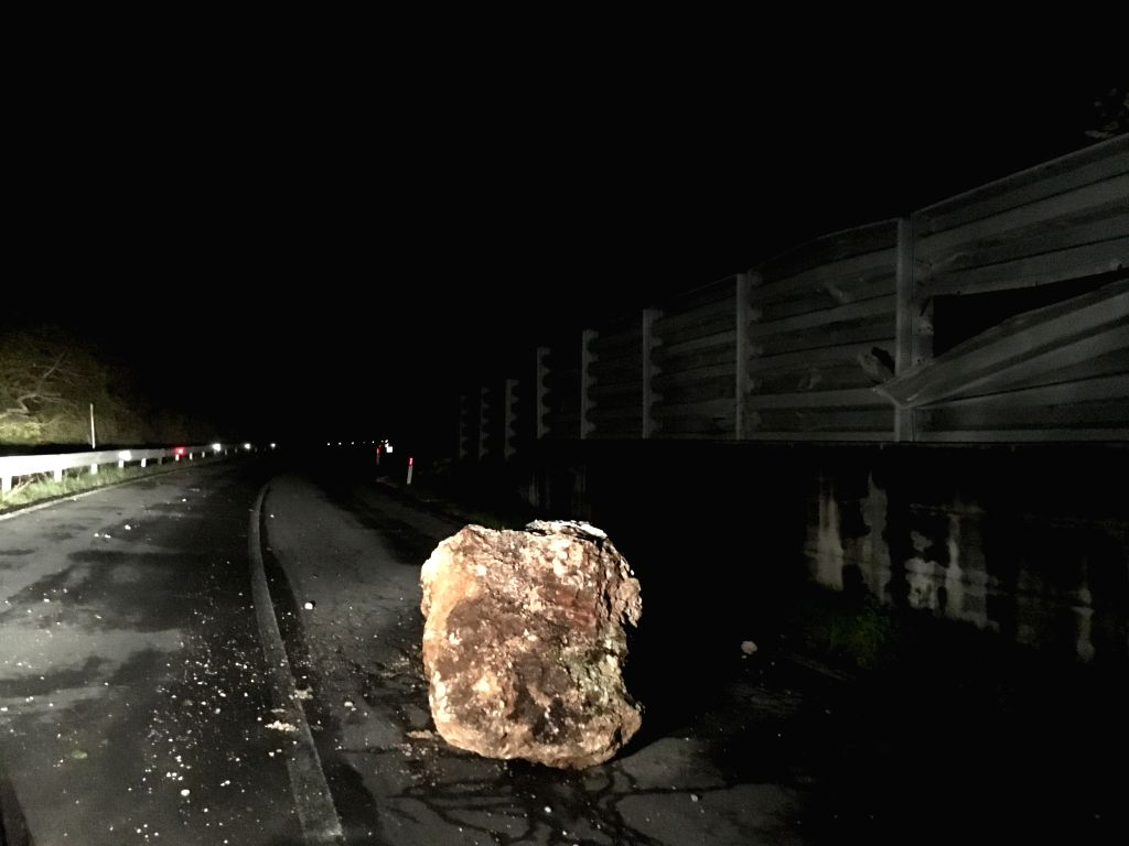 VISSO, Oct. 27, 2016 - A rock shaken down in a quake lies on a road in Visso, Italy, Oct. 27, 2016. Two powerful earthquakes hit central Italy late Wednesday, bringing down buildings and wreaking ...