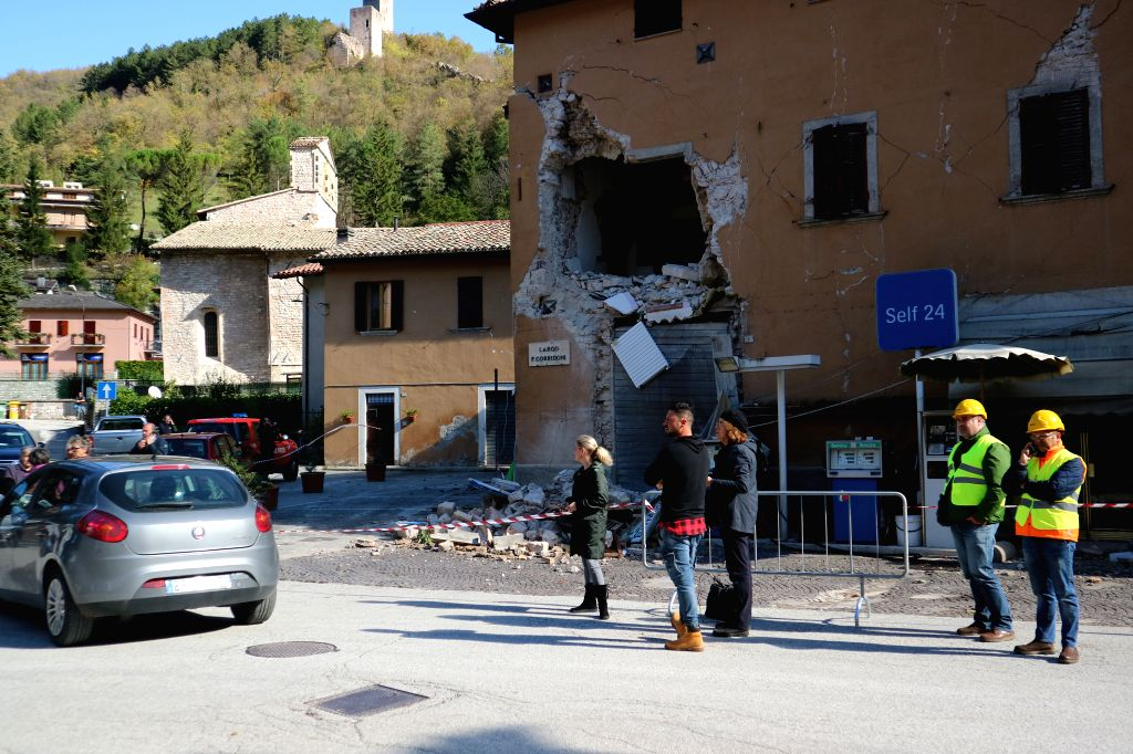 VISSO, Oct. 27, 2016 - Rescuers work beside an earthquake-damaged building in Visso, central Italy, Oct. 27, 2016. Two powerful earthquakes hit central Italy late Wednesday, bringing down buildings ...