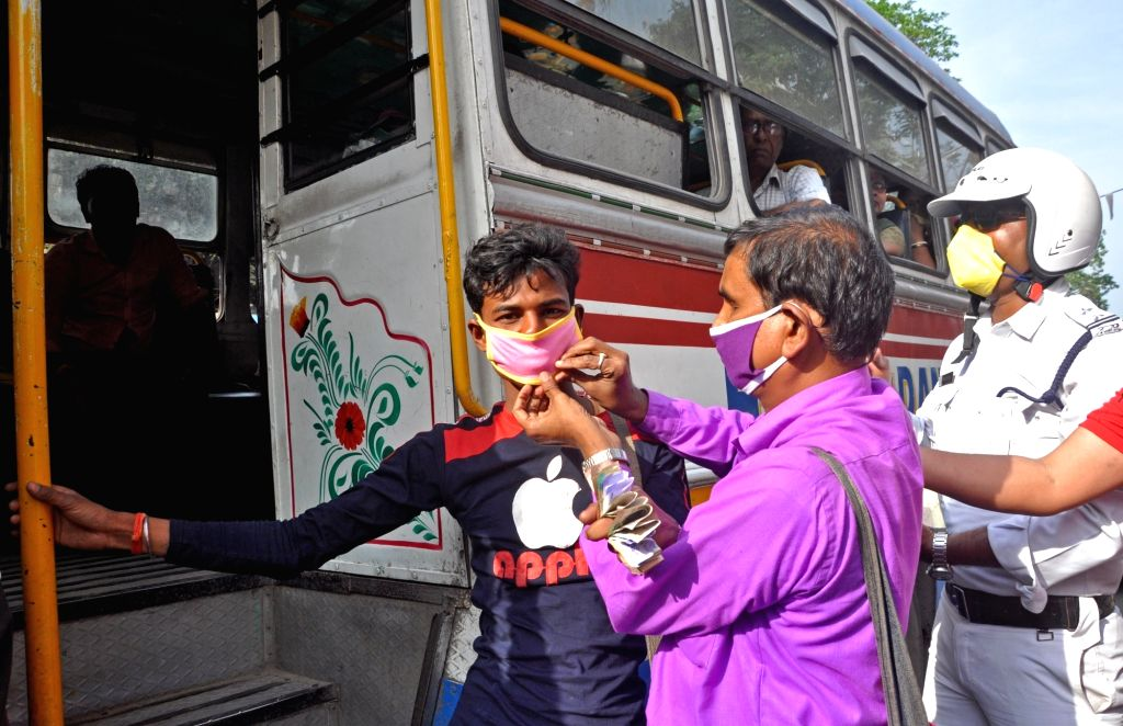 Visually impaired make bus conductors wear masks as an awareness campaign after COVID-19 (coronavirus) outbreak in Kolkata, on 19 March 2020.