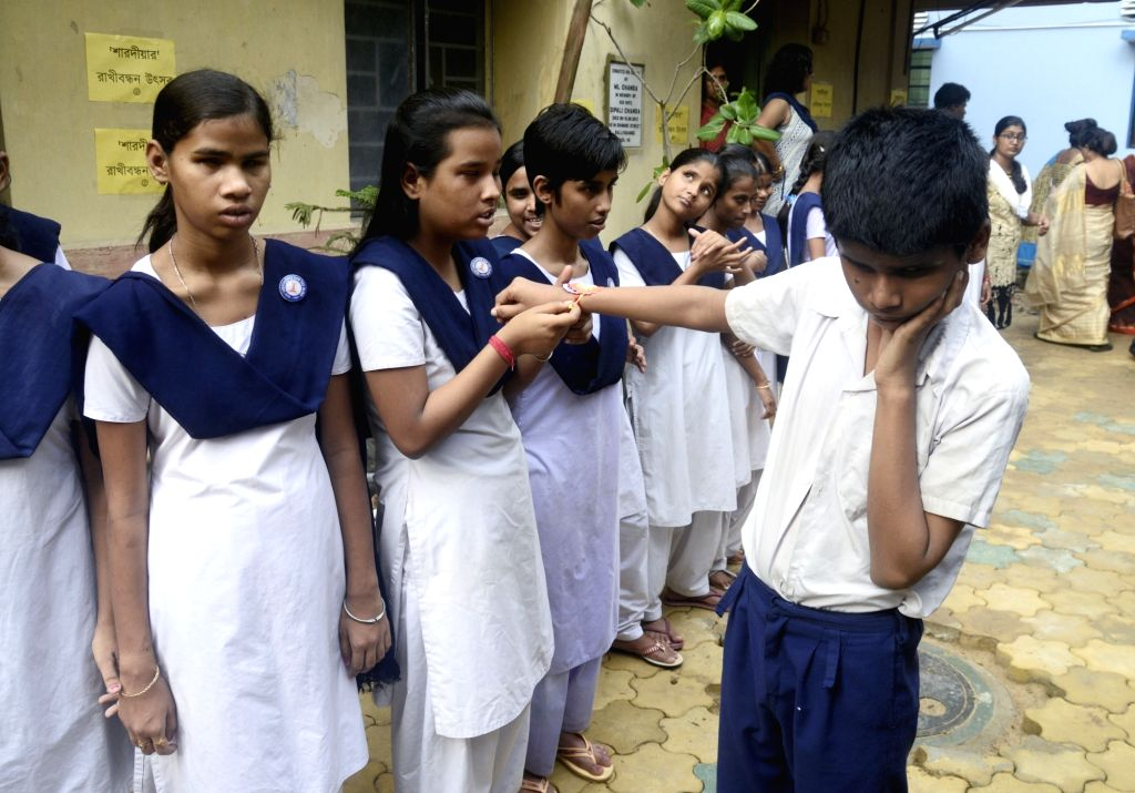 Visually impaired students during a pre-Rakhi celebrations at their school in Kolkata on Aug 5, 2017.