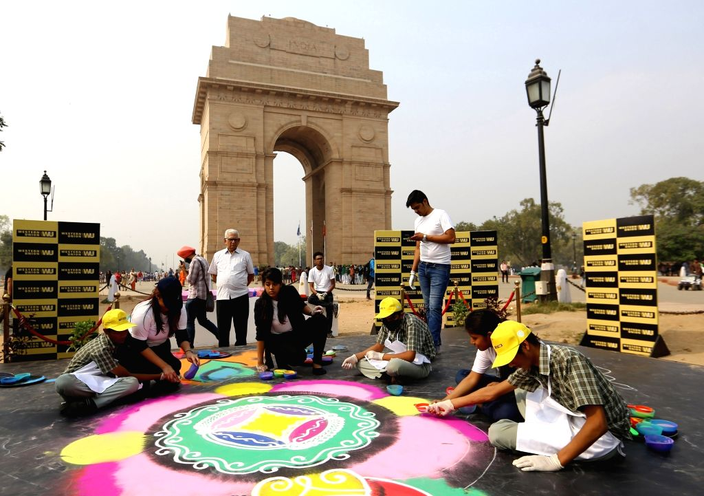 Visually impaired students from various NGOs rangoli during Diwali celebrations, at India Gate in New Delhi on Nov 3, 2018.