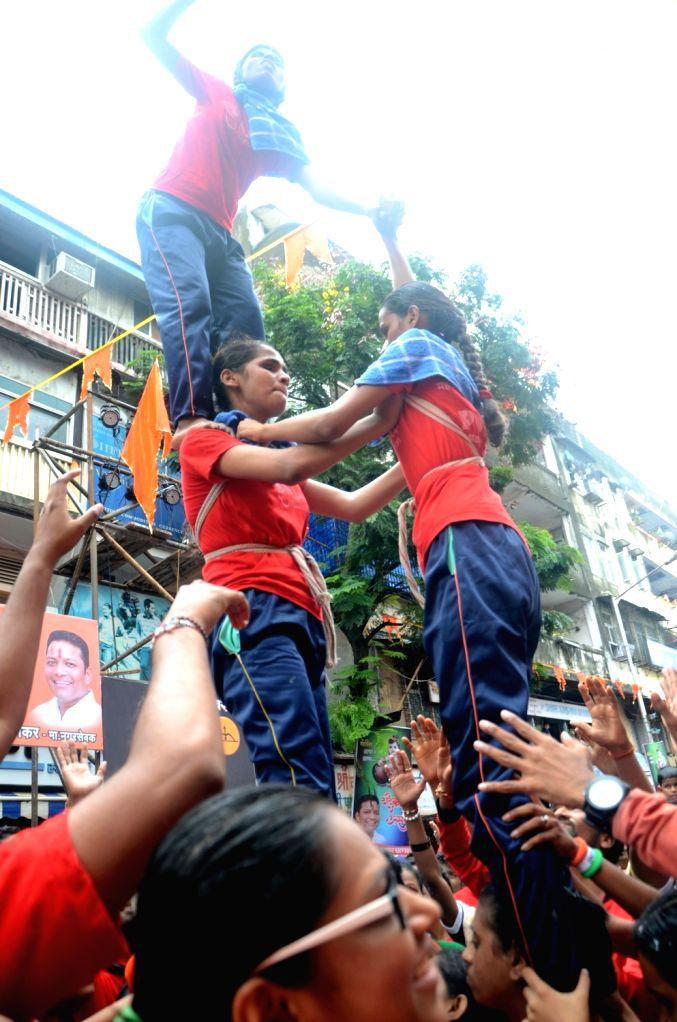 Visually impaired students participate in Dahi Handi festival on Krishna Janmashtami in Mumbai on Aug 15, 2017.