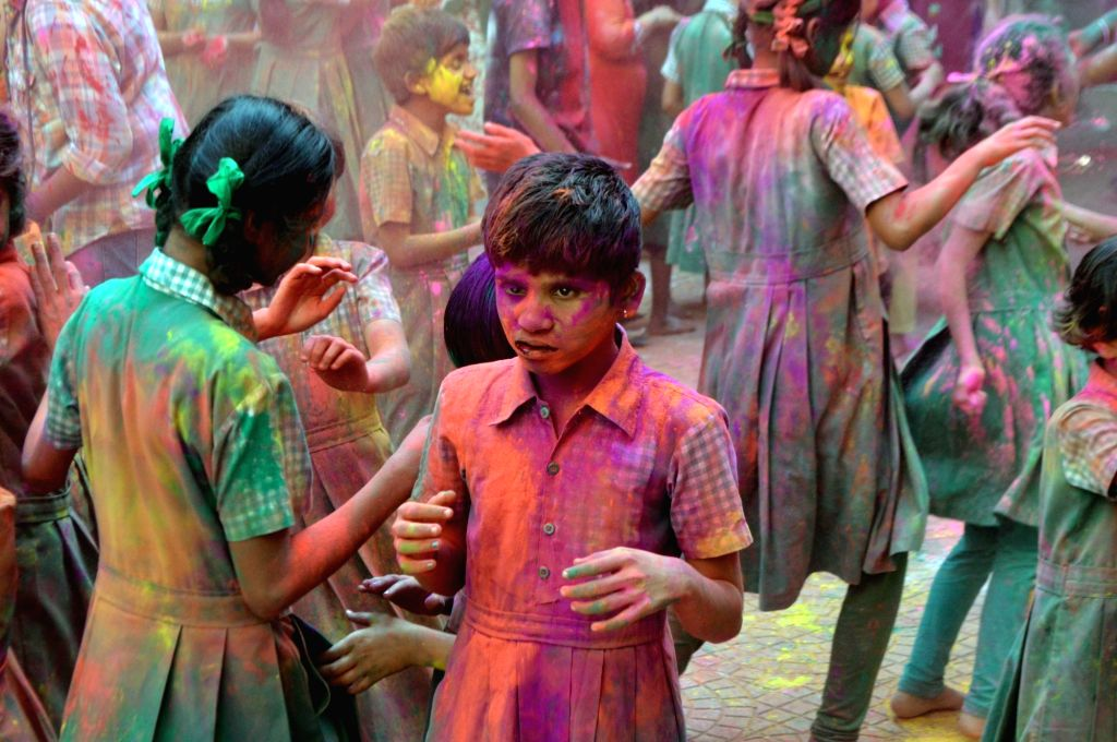 Visually impaired students play with colours ahead of Holi in Mumbai on March 10, 2017.
