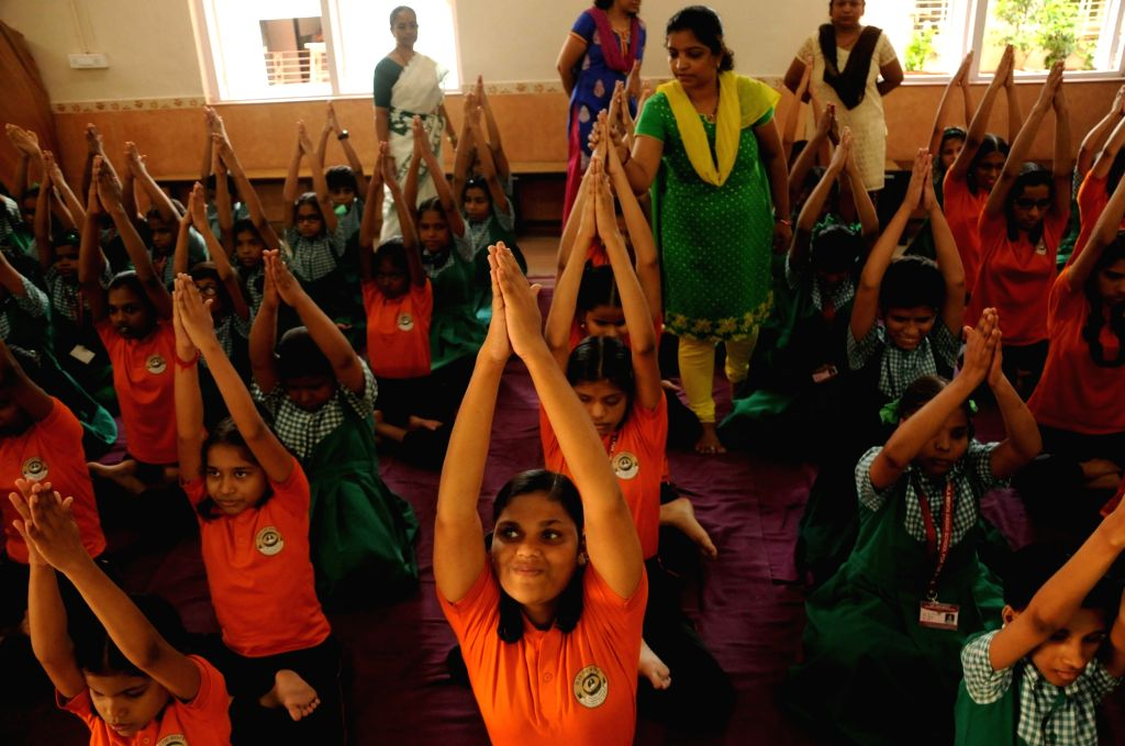 Visually impaired students practice Yoga Asans -postures- on International Yoga Day in Mumbai on June 21, 2017.