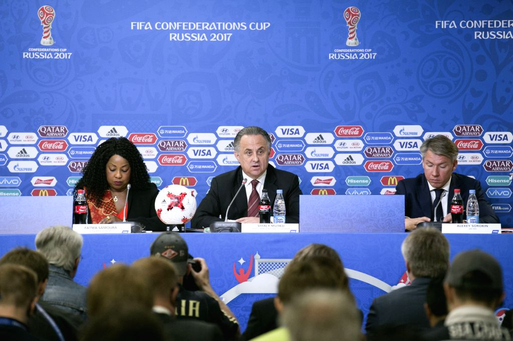 Vitaly Mutko, Russian Federation Deputy Prime Minister and Local Organising Committee (LOC) Chairman (C) speaks during a press conference before the FIFA ...
