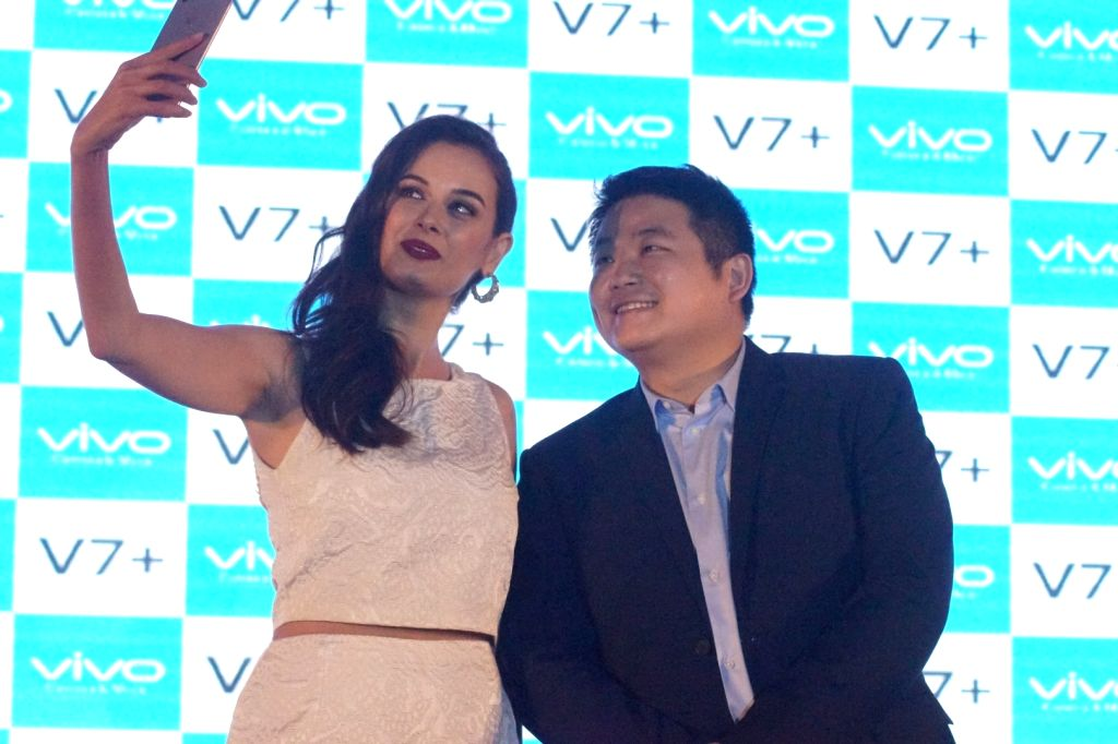 Vivo India CEO Kent Cheng along with Actress Evelyn Sharma during the launch of Vivo V7+ smartphone in Mumbai on Sept 11, 2017. - Evelyn Sharma