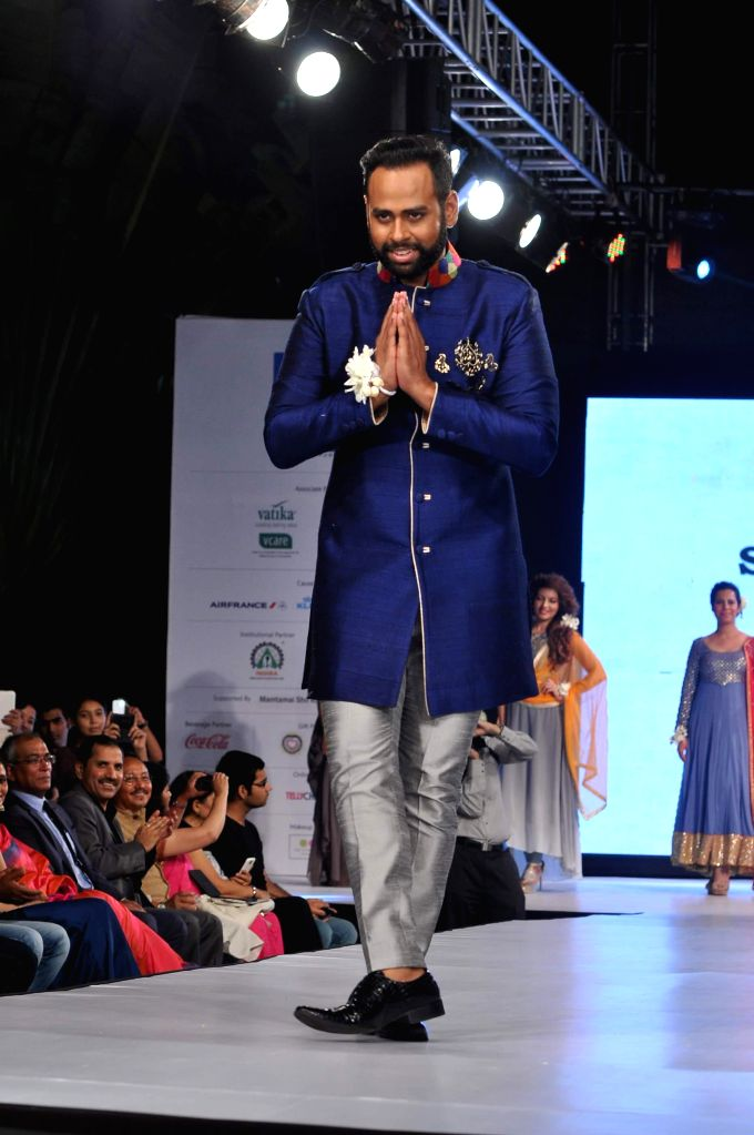 VJ Andy walks on the ramp during the 5th edition of charity fashion show, Ramp for Champs organised by Smile Foundation, in Mumbai, on April 19, 2014.
