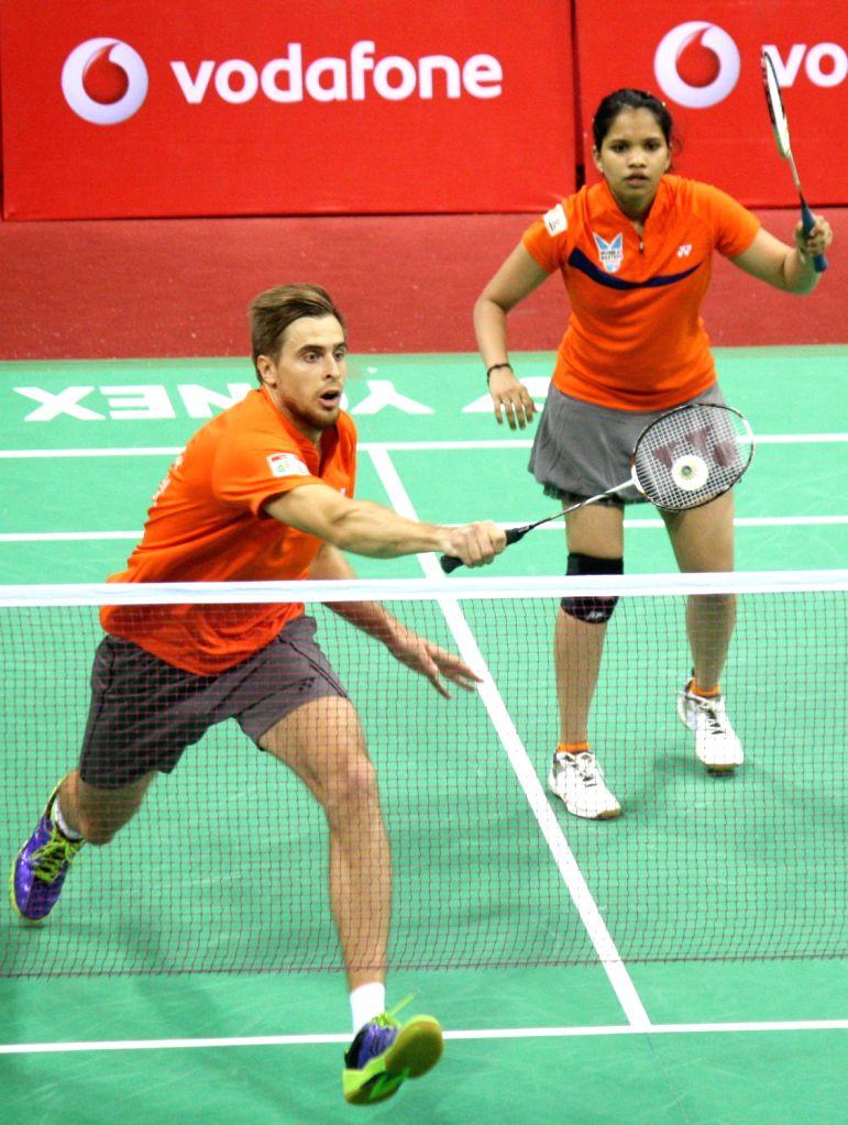 Vladimir Ivanov and N. Sikki Reddy of Mumbai Masters beats Banga Beats at IBL-2013 in New Delhi on August 15,2013. (Photo::: Amlan Paliwal/IANS) - N. Sikki Reddy