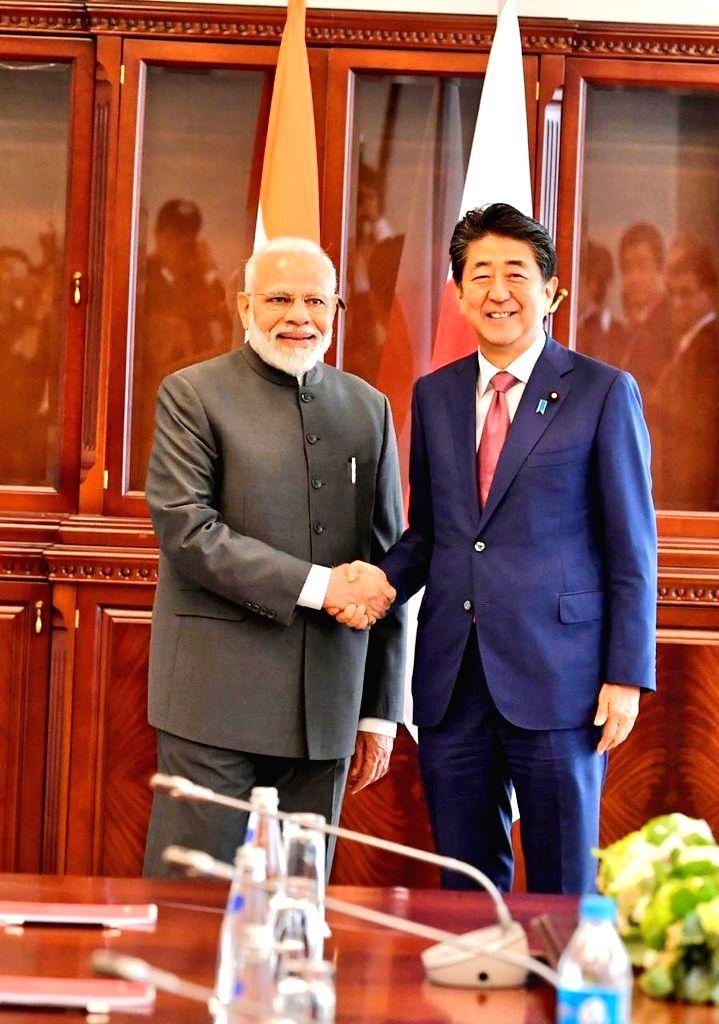 Vladivostok: Prime Minister Narendra Modi meets Japanese Prime Minister Shinzo Abe on the margins of the 5th Eastern Economic Forum in Vladivostok, Russia on Sep 5, 2019. (Photo: IANS/MEA) - Narendra Modi