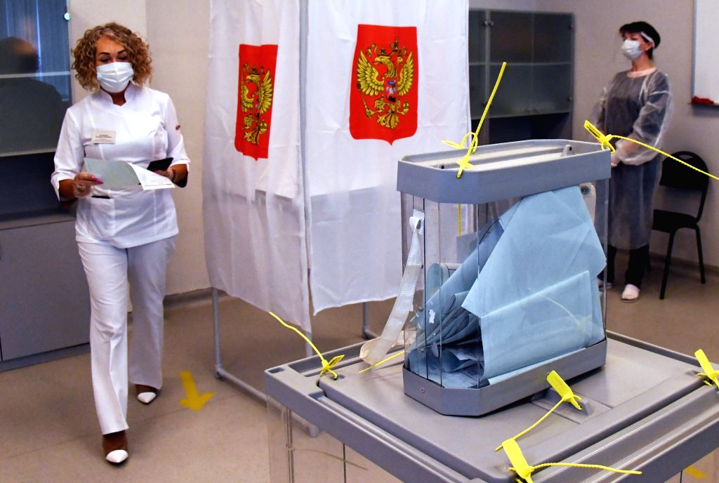 Vladivostok (RUSSIA), June 25, 2020 A medical worker prepares to cast her ballot during a vote on constitutional amendments in Vladivostok, Russia, on June 25, 2020. The all-Russian vote ...