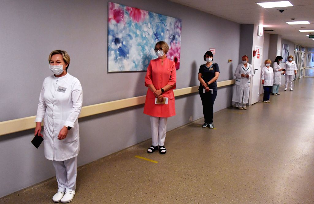 Vladivostok (RUSSIA), June 25, 2020 Medical workers queue to vote on constitutional amendments in Vladivostok, Russia, on June 25, 2020. The all-Russian vote on constitutional amendments, ...