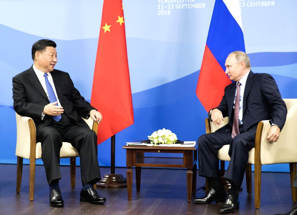 VLADIVOSTOK, Sept. 11, 2018 - Chinese President Xi Jinping (L) holds talks with Russian President Vladimir Putin in Vladivostok, Russia, Sept. 11, 2018.