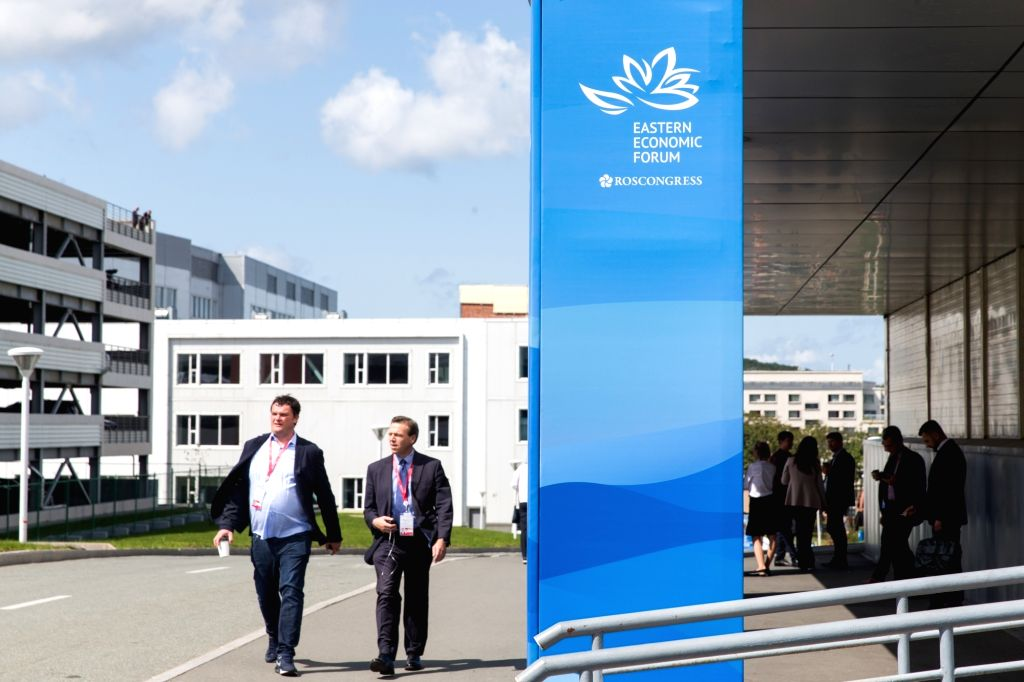 VLADIVOSTOK, Sept. 11, 2018 - People walk past a sign of the Eastern Economic Forum in Vladivostok, Russia, on Sept. 11, 2018. World leaders and business tycoons gathered in Russia's Far Eastern port ...