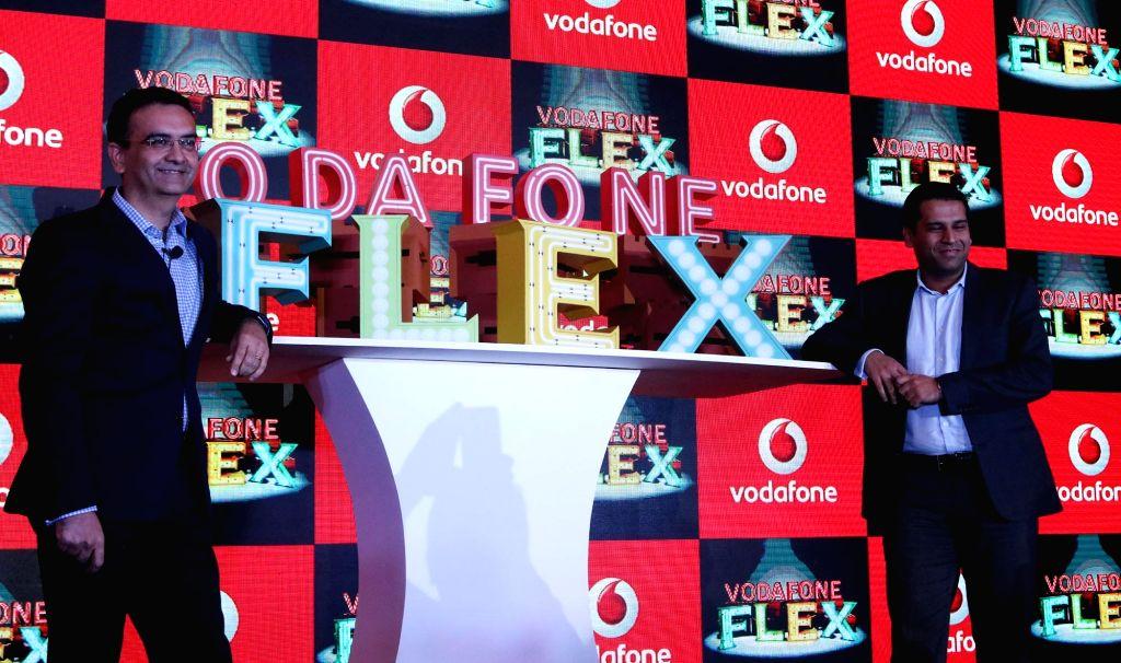 "Vodafone India officials Sandeep Katria and Arvind Nevatia launch ""Vodafone Flex"" in New Delhi, on Sept 20, 2016."