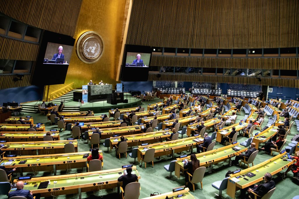 Volkan Bozkir (rear L), president of the 75th session of the United Nations General Assembly (UNGA), addresses a high-level meeting to commemorate the 75th ...