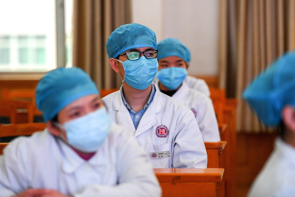 Volunteers are seen during training courses for fighting against the novel coronavirus epidemic at Mawangdui section of People's Hospital of Hunan Province in ...