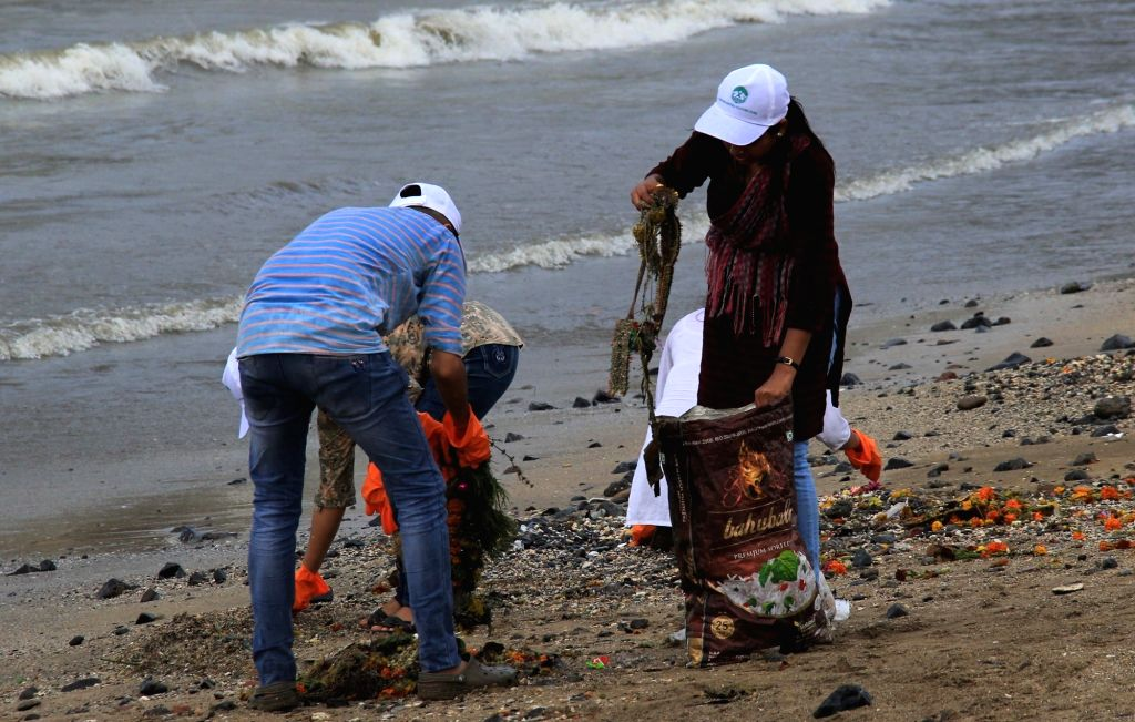 Volunteers clean Girgaum Chaupati after Ganesh immersions in Mumbai, on Sept 11, 2016.