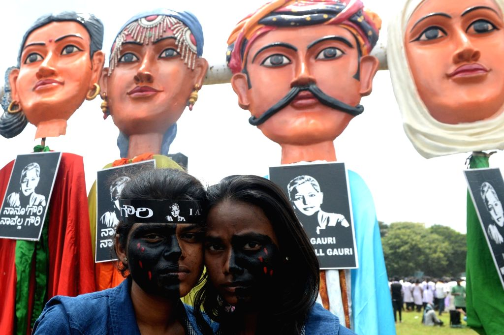 Volunteers during a protest rally against the killing of journalist turned activist Gauri Lankesh at Central College Ground in Bengaluru on Sept 12, 2017.