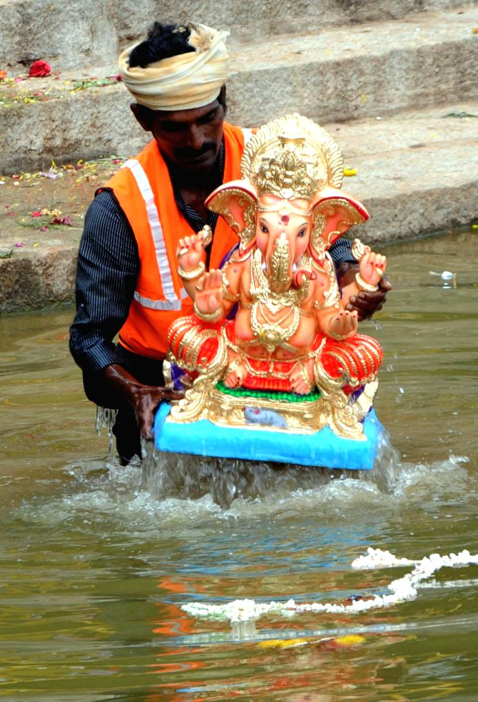 Volunteers immersing Ganesha idols, celebrating Ganesha Chaturthi Festival, at Ulsoor Lake in Bangalore on Aug. 30, 2014.