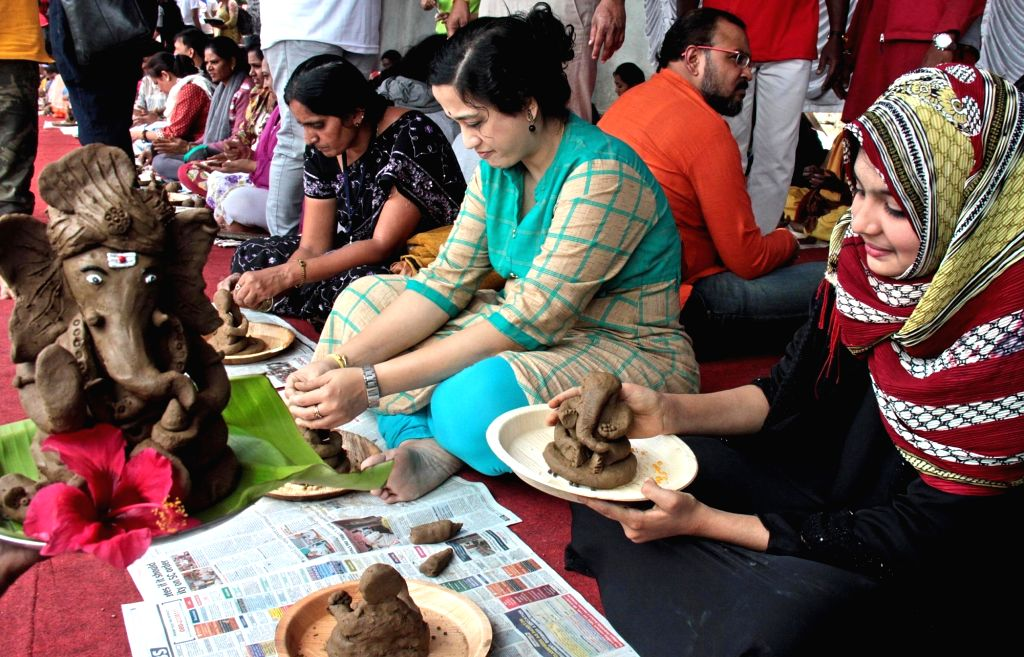 Volunteers making eco-friendly clay Ganeshas idols to create awareness and promote eco-friendly Ganesha's organised by BBMP at Ulsoor Lake, in Bengaluru on Aug 11, 2019.