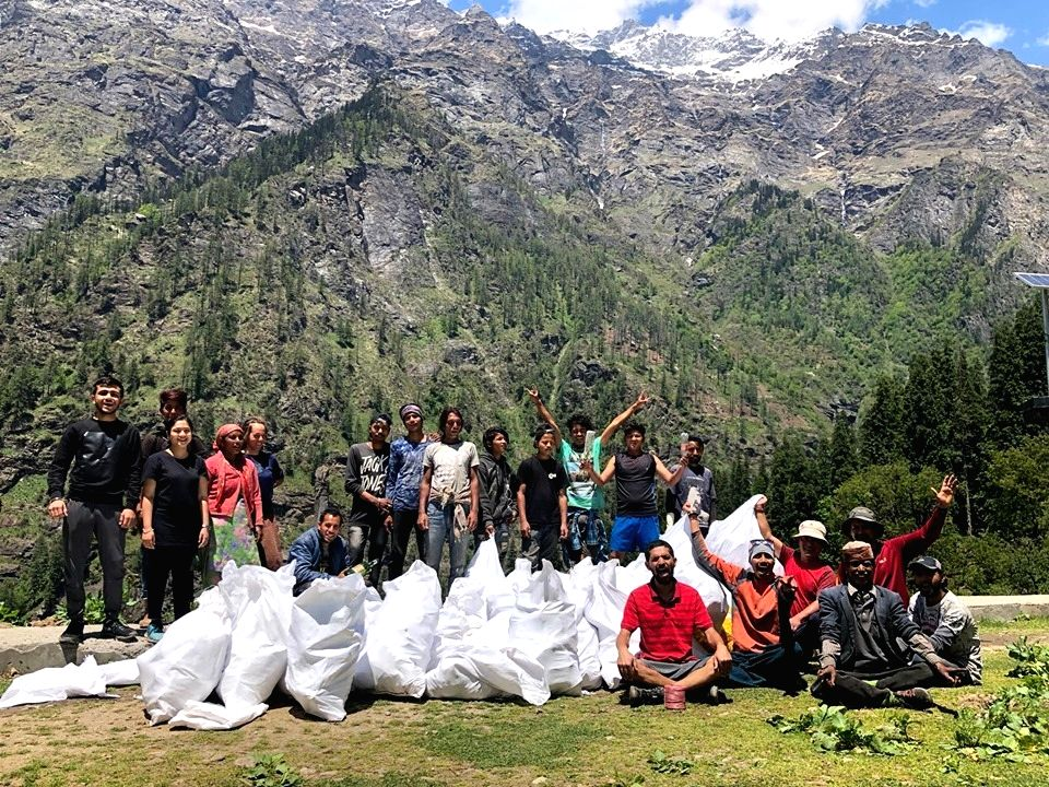 Volunteers of the Healing Himalayas Foundation with trash collected from the Himalayas. (Source: Facebook)
