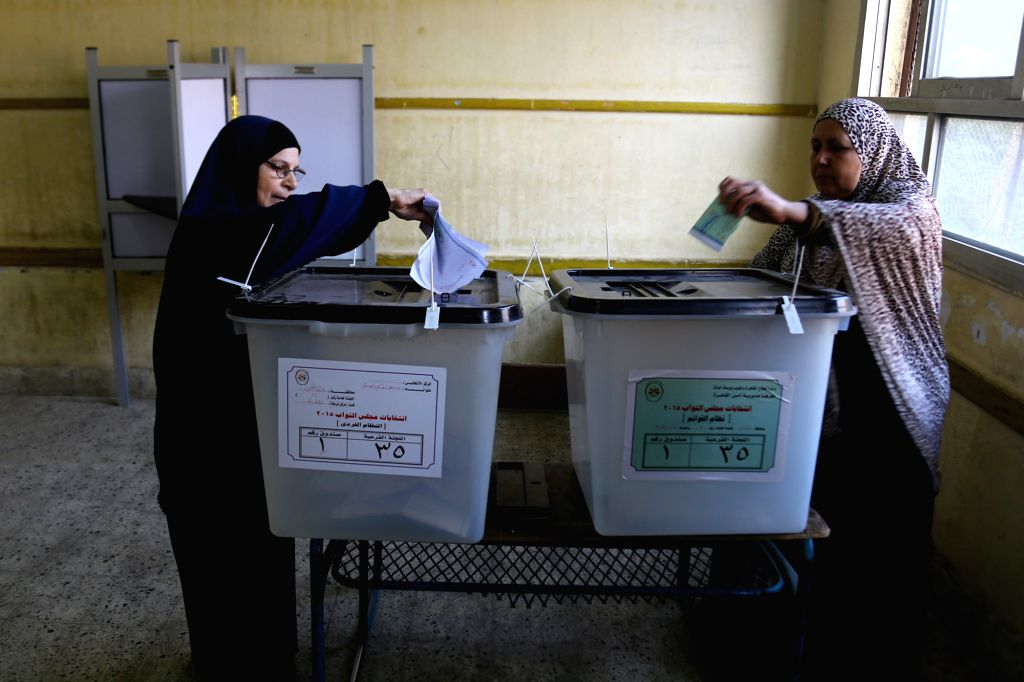 Voters cast their ballots at a polling station in Cairo, Egypt, Nov. 22, 2015. Egyptians began voting Sunday in the second phase of the country's first parliamentary ...