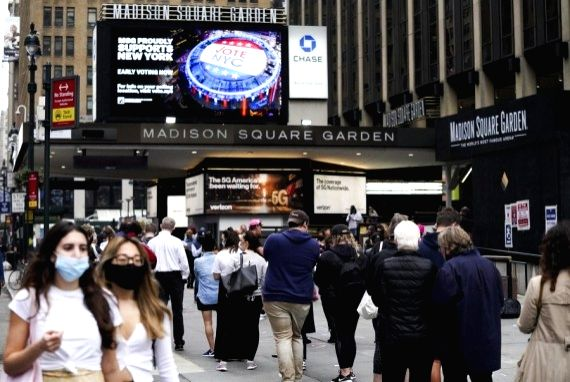 Voters line up to vote during the in-person early voting at a polling station in Madison Square Garden in New York, the United States, Oct. 24, 2020.