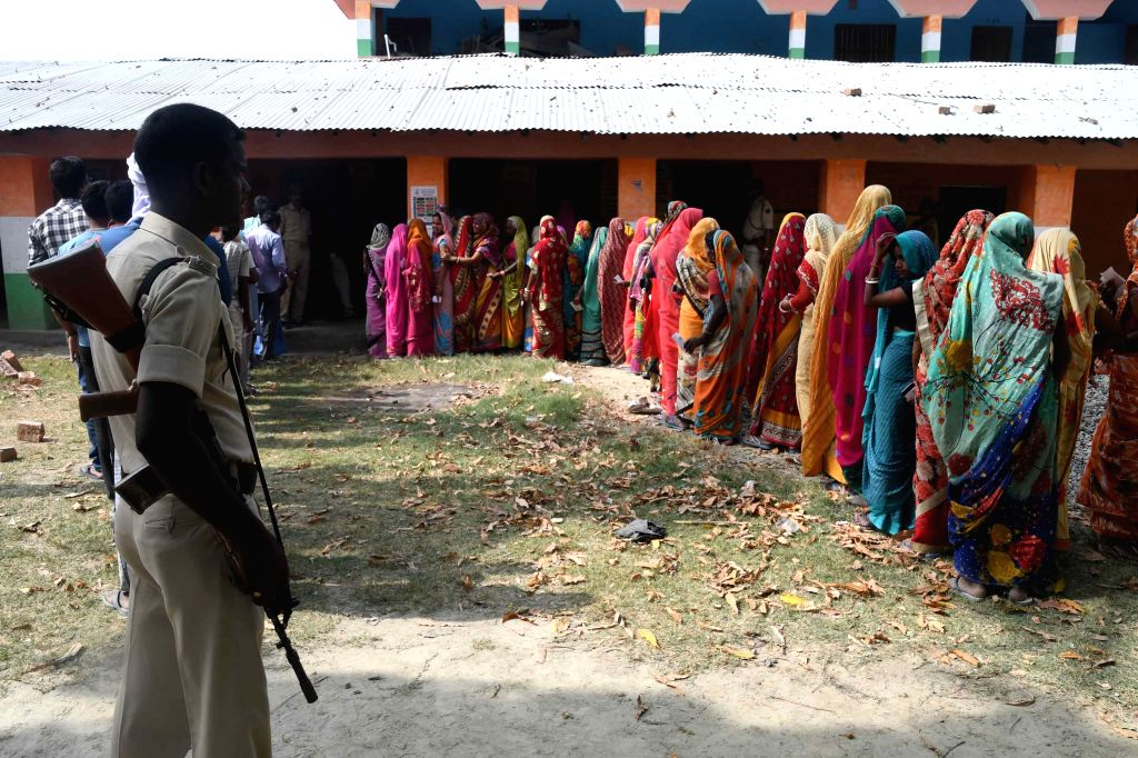 Voters queue up at a polling station to cast their votes for the fourth phase of 2019 Lok Sabha elections in Bihar's Samastipur, on April 29, 2019.