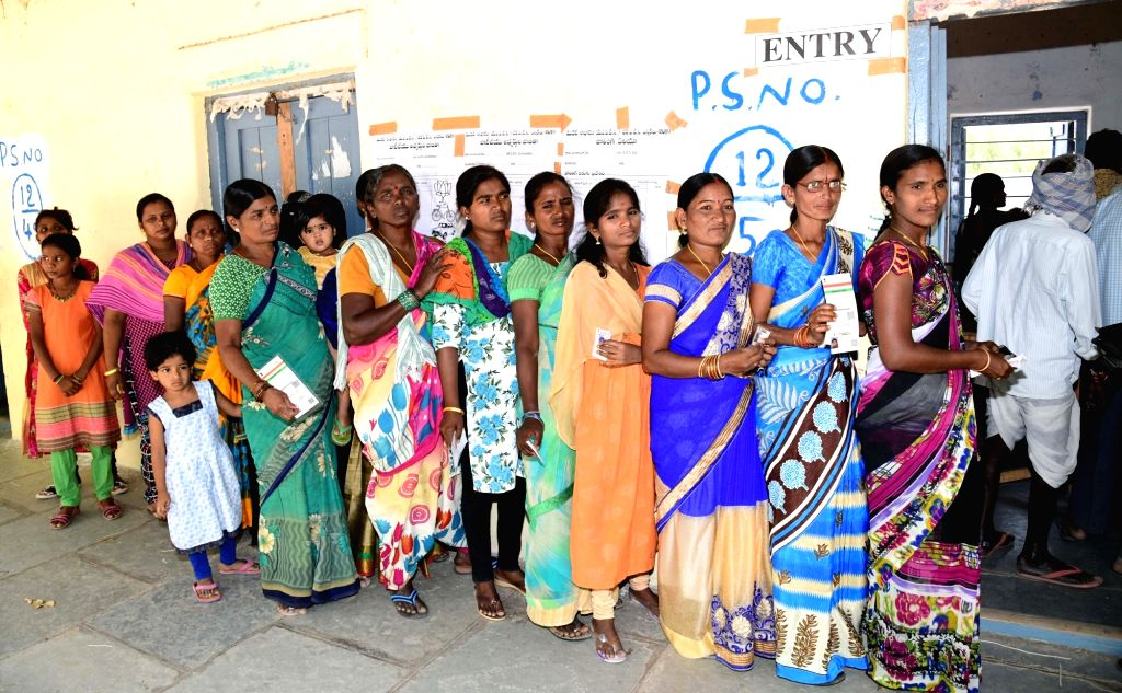 Voters queue up at a polling station to cast their votes during elections to the first phase of the three-phased Mandal Parishad Territorial Constituencies (MPTC) and Zilla Parishad ...