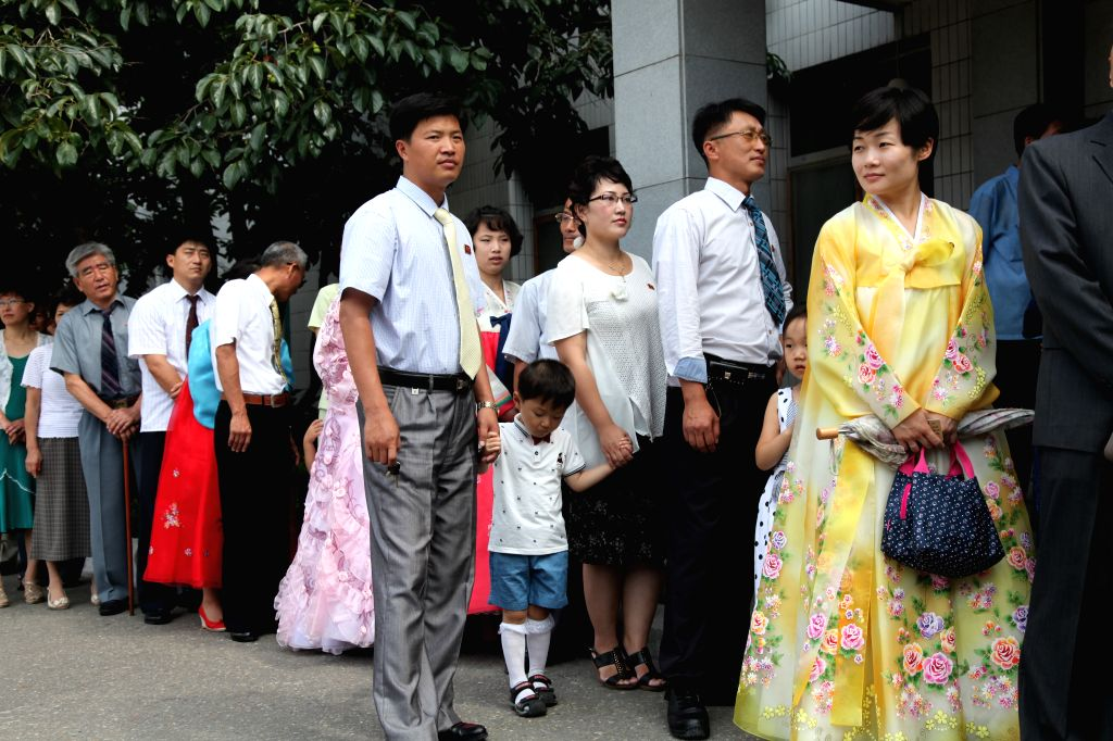 Voters queue up outside a polling station in Pyongyang, the Democratic People's Republic of Korea (DPRK), July 19, 2015. The election of deputies to local ...