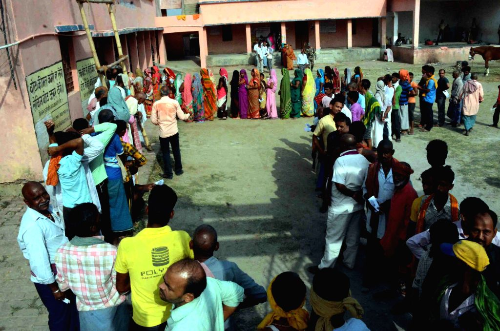 Voters queue up to cast their votes for the fourth phase of 2019 Lok Sabha elections, in Bihar's Munger on April 29, 2019.